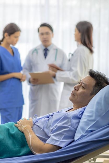 Worried Patient In Bed Photo Premium Download