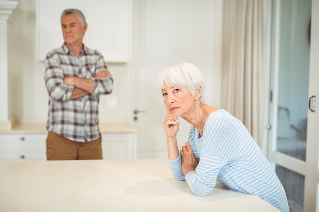 Worried senior couple in kitchen Premium Photo