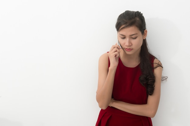 Worried young asian business woman with phone Premium Photo