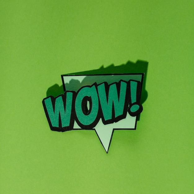 Wow! speech bubble in retro style on dark green backdrop Free Photo