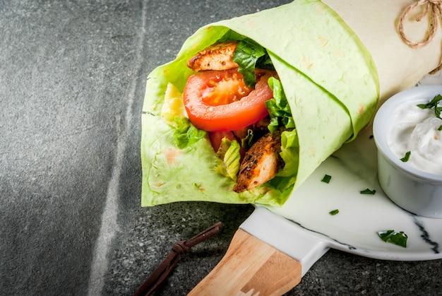 Wrap sandwich with green tortillas Premium Photo