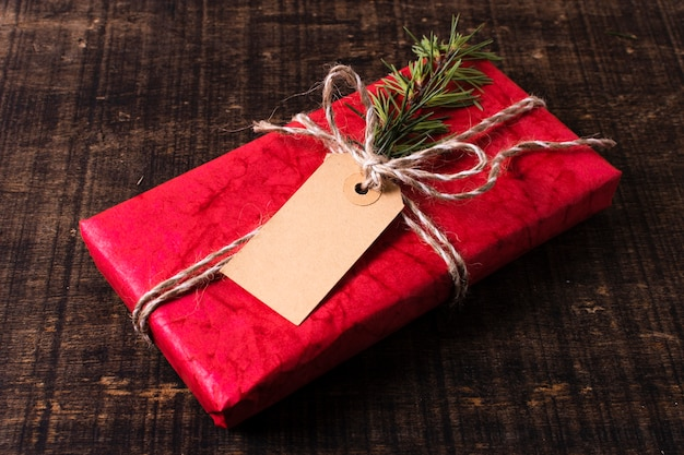 Wrapped christmas gift with empty tag Free Photo