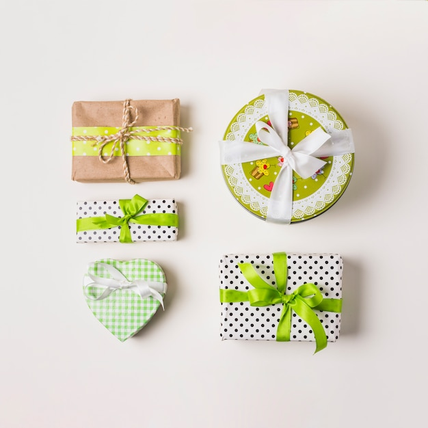 Wrapped gift arrangement over white backdrop Free Photo