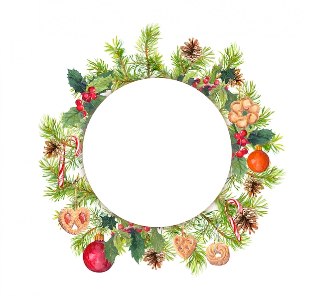Wreath - christmas tree branches, mistletoe, cookies, candy cane Premium Photo