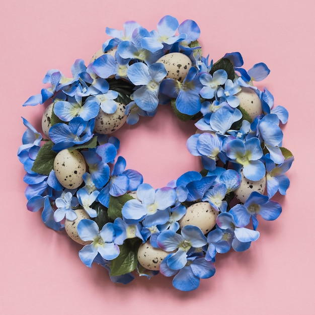 Wreath made from blue flowers and eggs Free Photo
