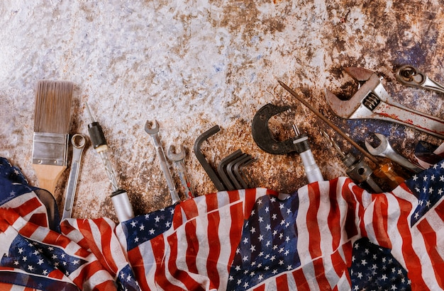 Wrench constructor tools on a united states of america flag in labor day is a federal holiday Premium Photo