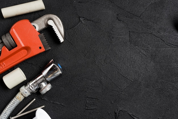 Wrench and equipment for plumbing Free Photo