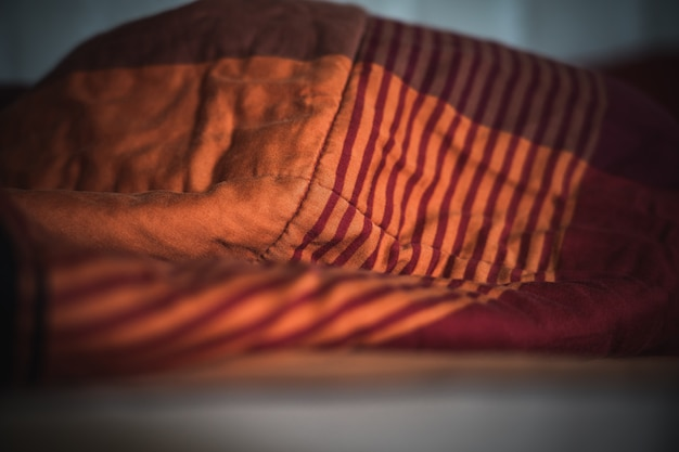 Wrinkle messy blanket in bedroom after waking up in the morning Premium Photo