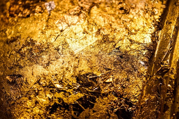 Wrinkled golden textured background Free Photo