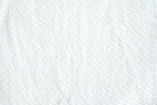 Wrinkled White Cotton Fabric Texture Background Wallpaper Photo