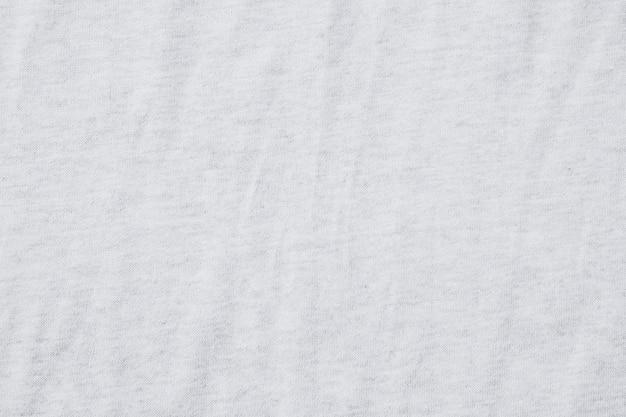 Wrinkled white cotton polyester, fabric texture background. Premium Photo