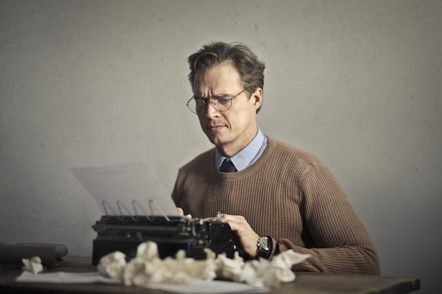 Writer working on a typewriter Premium Photo