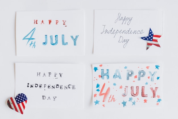 Writing happy 4th july on cards Free Photo