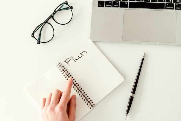 Writing a plan in a notebook with a copy space. business concept - work in a bright modern office Premium Photo
