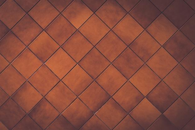 茶色のレンガの背景で交差する線。 x線 Premium写真