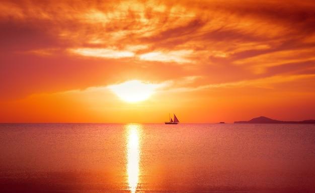 Yacht sailing against sunset. holiday lifestyle landscape with skyline. vintage process. Free Photo