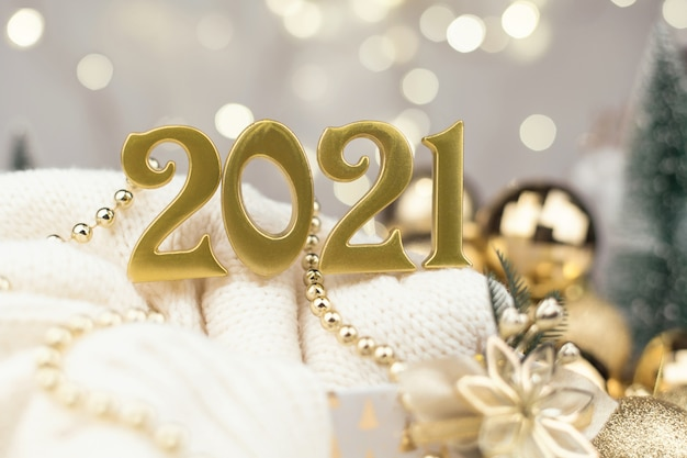 Year 2021 numbers on golden bokeh background new year, Premium Photo