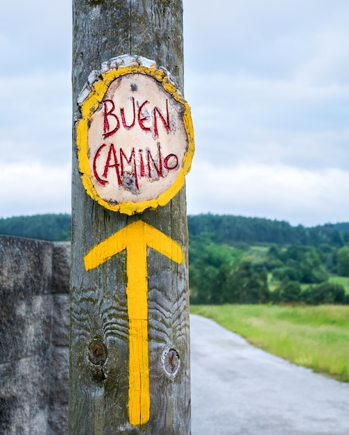 Yellow arrow, sign for pilgrims on the camino de santiago in spain, way of st james Premium Photo