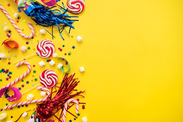 yellow background with variety of birthday elements photo free