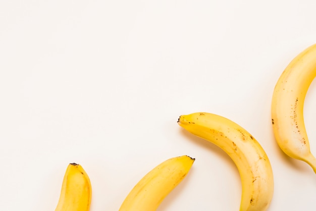 Yellow bananas on white background Free Photo