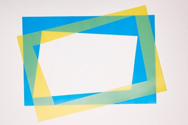 Yellow and blue border frame on white backdrop Free Photo