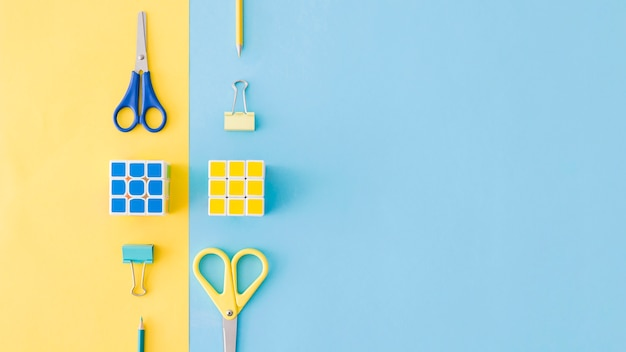 Yellow and blue compositions of stationery Free Photo