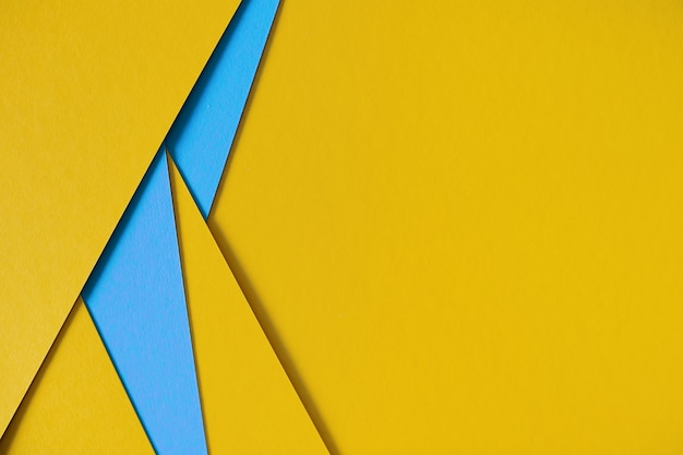 Yellow and blue geometric composition paperboard background with copyspace Free Photo