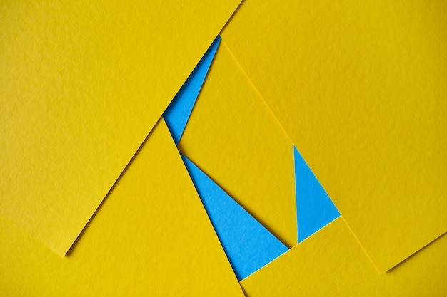 Yellow and blue geometric composition yellow and blue paperboard background Free Photo