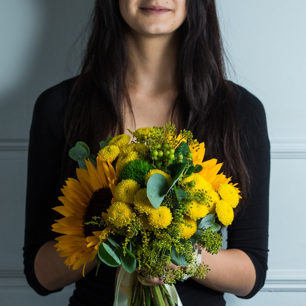 Yellow bouquet of winflowers and sunflowers Free Photo