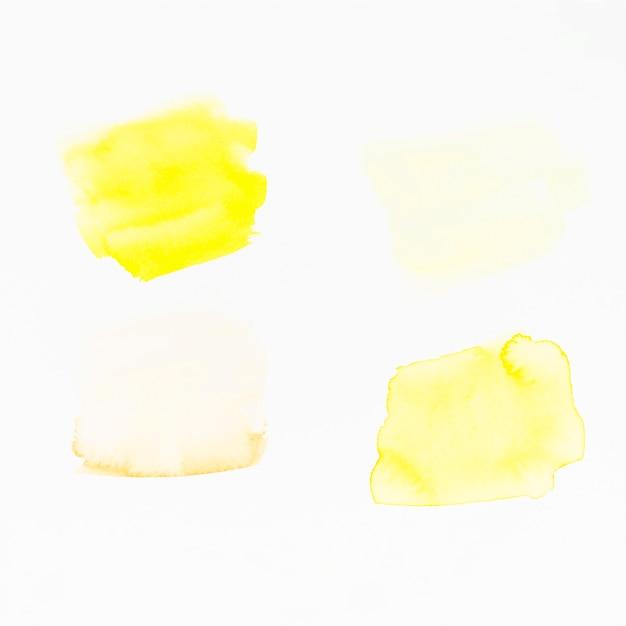 Yellow brush strokes on white backdrop Free Photo