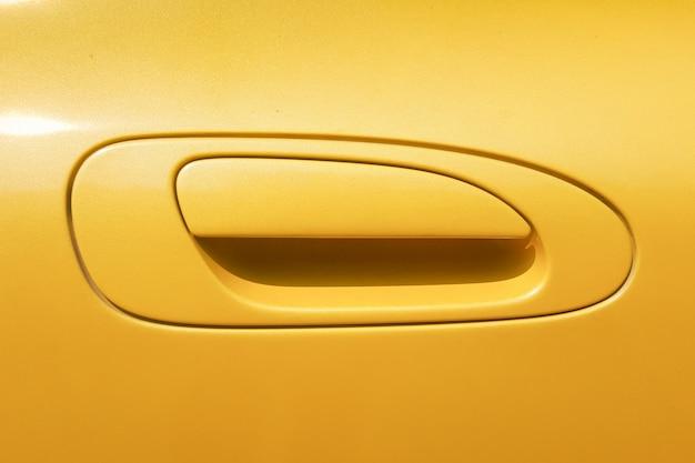 Yellow car door handle Premium Photo