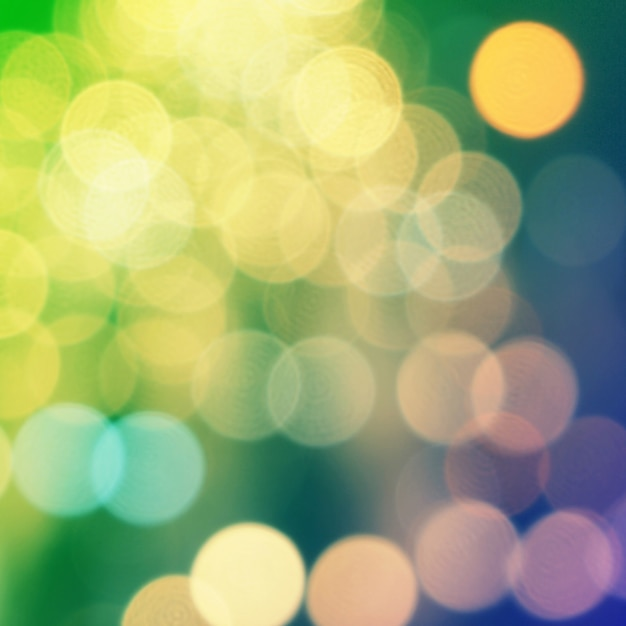 Yellow christmas background with bokeh lights Premium Photo
