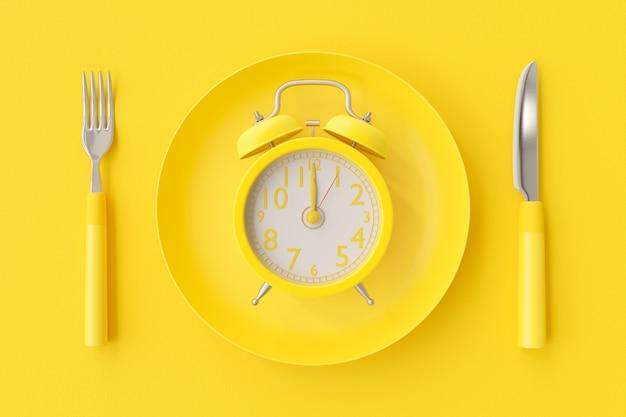 Yellow clock on the yellow plate Premium Photo