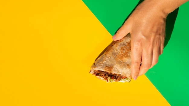 Yellow copy space background and delicious mexican taco Free Photo