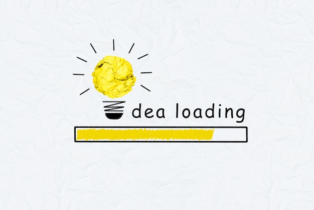 Yellow crumpled paper light bulb graph increasing and idea loading text Premium Photo