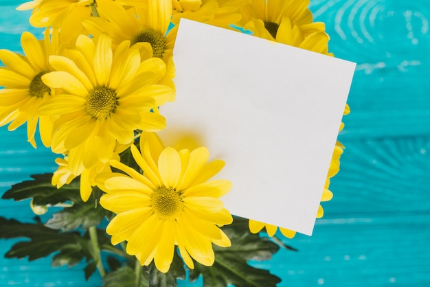 Yellow daisies with blank note Free Photo