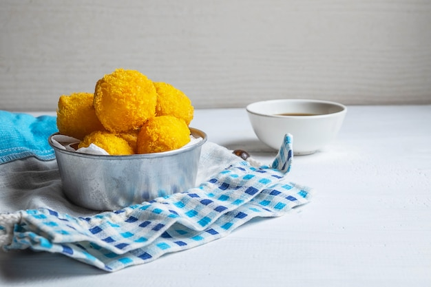 Yellow delicious fried ball cheese Premium Photo