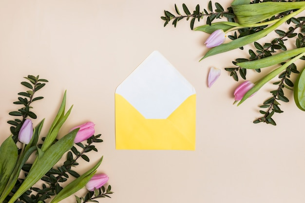 Yellow envelope and flowers Free Photo
