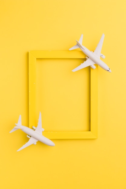 Yellow frame with toy planes Free Photo
