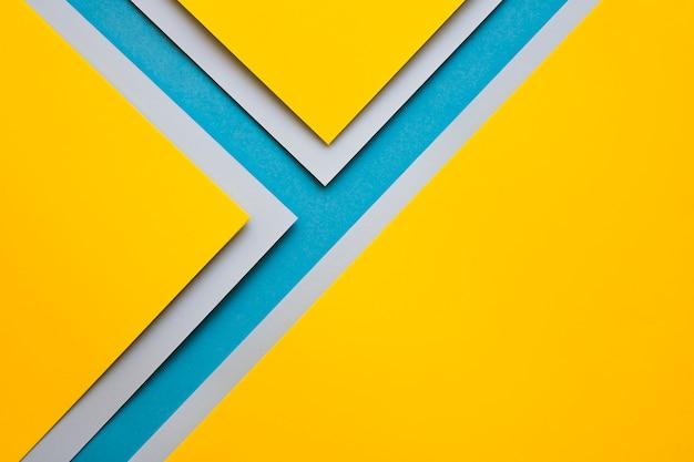 Mestieri gialli e grigi sulla superficie blu Foto Gratuite