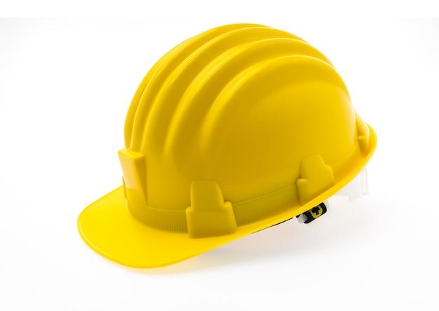 Желтый жесткий пластмассовый шлем строительство на белом фоне. Бесплатные Фотографии