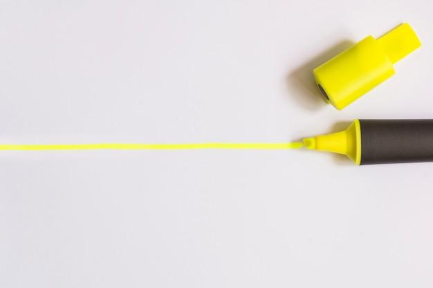 Yellow highlighter on white Premium Photo