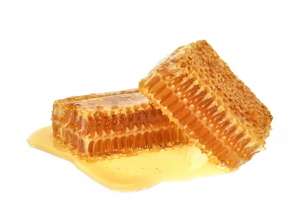 Yellow honeycomb slice closeup isolated on white background Premium Photo