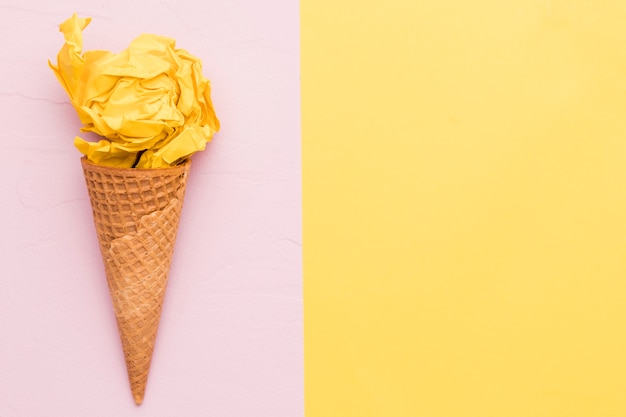 Yellow ice cream on different color background Free Photo