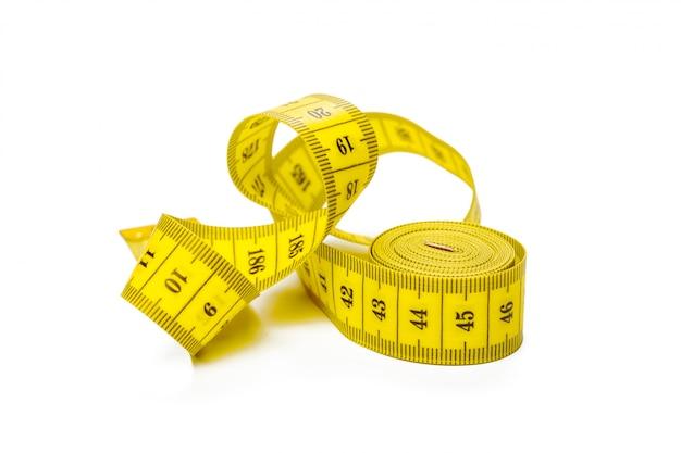 Yellow metric measuring tape isolated Premium Photo