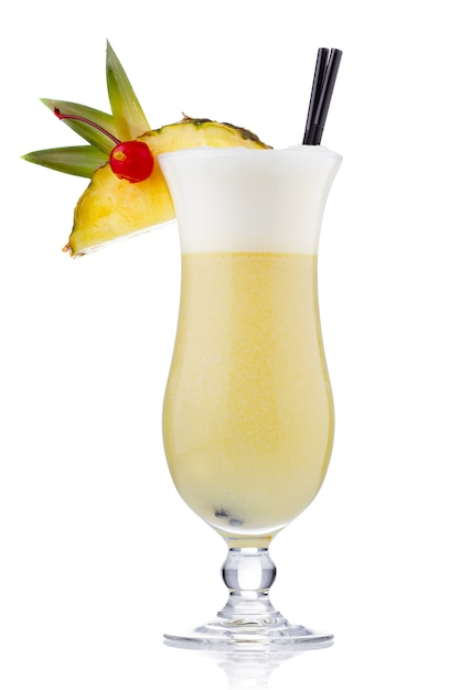 Yellow milk cocktail with berries and pineapple slice isolated Premium Photo