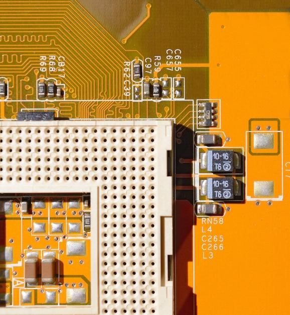 Yellow motherboard with empty socket Premium Photo