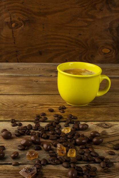 Yellow mug of strong coffee and brown sugar Premium Photo