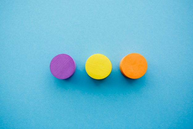 Yellow, orange and purple circle in the center on a blue backgro Premium Photo