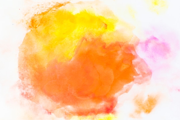 Yellow and orange watercolor spills Free Photo